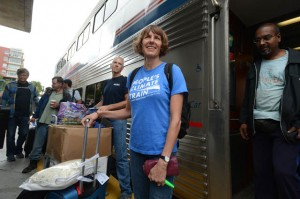 Wearing a shirt of her own design, Linda Currie prepares to board the Climate Train in Emeryville.  Photo:  Kristopher Skinner/Bay Area News Group